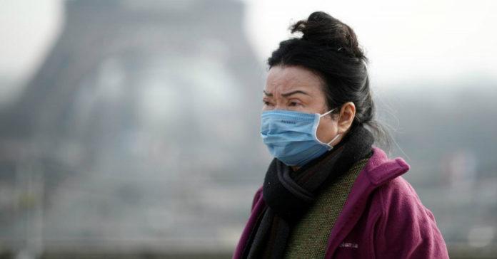 an elderly woman wearing mask
