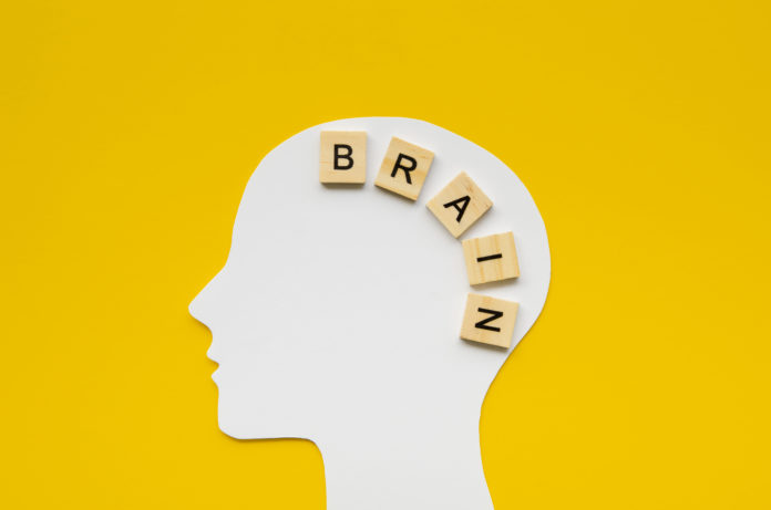 white head with brain word from scrabbles letters